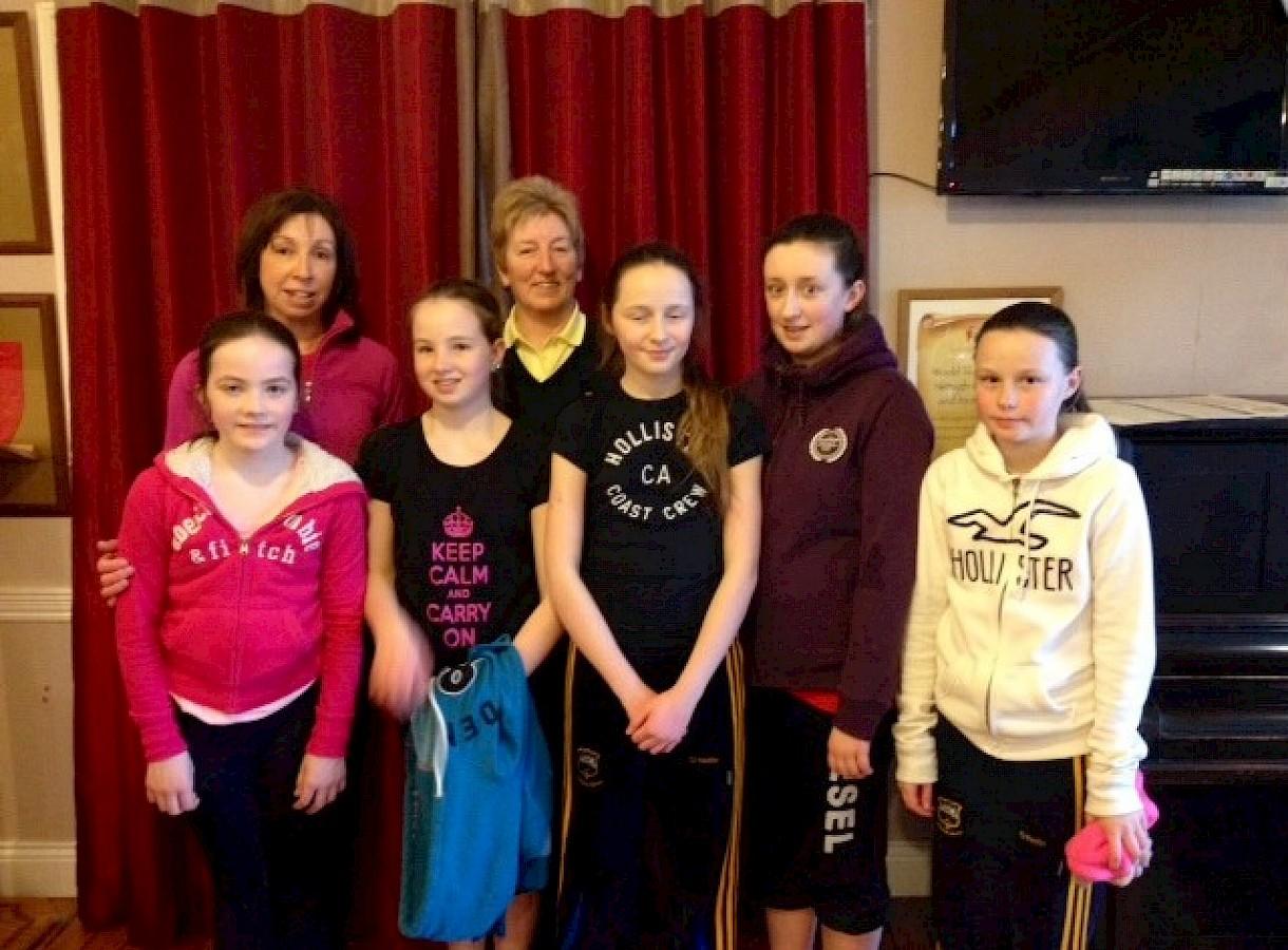 Junior girl golfers with Lady Captain Carmel Vekins and Junior Girls Convenor Helen McMahon