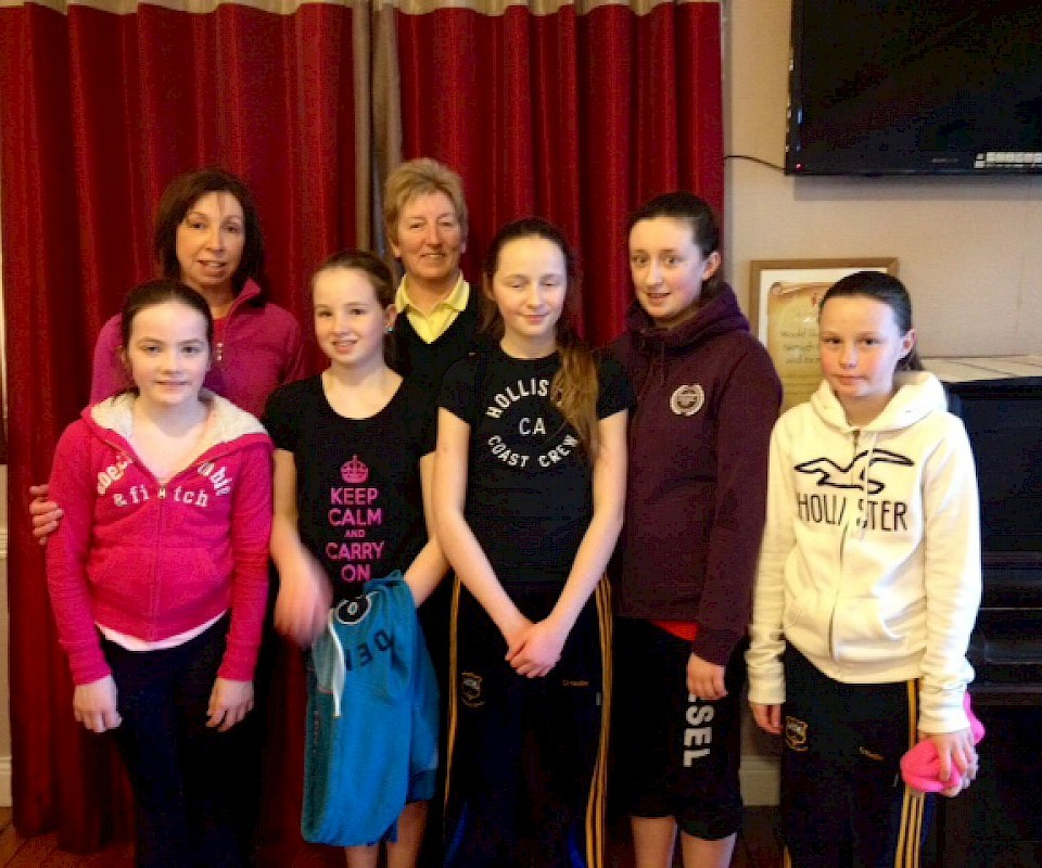 Junior girl golfers with Lady Captain Carmel Vekins and Junior Girls Convenor Helen McMahon